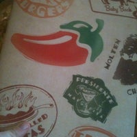 Photo taken at Chilis Texas Grill by Allan C. on 4/11/2012