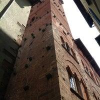 Photo taken at Torre Guinigi by Mari C. on 5/29/2012