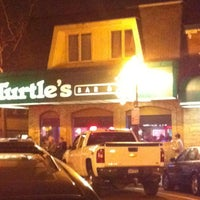 Photo taken at Turtle's Bar and Grill by Brad T. on 12/1/2012