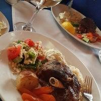 Photo taken at Asteras Greek Taverna by Caren R. on 2/18/2014