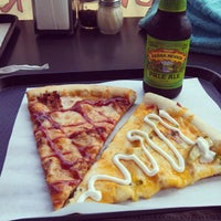 Photo taken at Carmine's Pizza by Mary W. on 4/19/2014