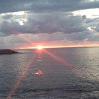 Photo taken at Piremit Beach by Melek B. on 9/7/2013
