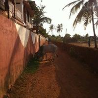 Photo taken at Morjim Beach(Goa) by J Kimbar on 8/5/2013
