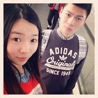 Photo taken at Gate 207 by Zhou Y. on 1/9/2014