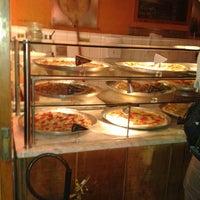 Photo taken at O Pedaço da Pizza by Danielle T. on 7/15/2013