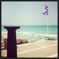 Photo taken at Sani Beach Club by Roy J. on 8/17/2013