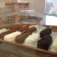 Photo taken at Rocky Mountain Chocolate Factory by Matthew V. on 7/27/2014
