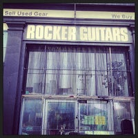 Photo taken at Rocker Guitars by lynn f. on 7/29/2013