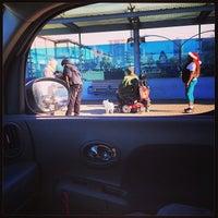 Photo taken at MUNI Bus Stop - Geary & Fillmore by lynn f. on 12/23/2013