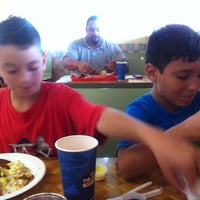 Photo taken at Pollo Tropical by Victor G. on 11/8/2013