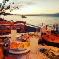Photo taken at NOSTOS Fish Restaurant by Hakan T. on 10/8/2016