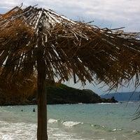 Photo taken at Mandraki beach by Billie-Jo W. on 9/2/2013