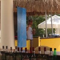 Photo taken at Palm Bar by Mete K. on 8/30/2013