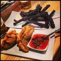 Photo taken at Uasabi Japanese Resto Bar by Miguel C. on 6/22/2013