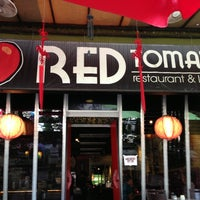 Photo taken at Red Tomato Restaurant & Lounge by Joanne L. on 7/21/2013