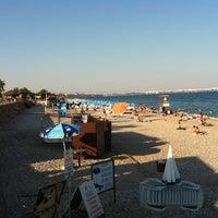 Photo taken at Konyaaltı Beach by Vedat ş. on 7/19/2013