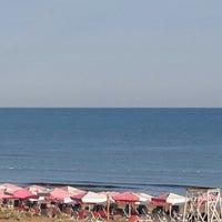 Photo taken at Yelken Beach by Rıdvan Y. on 8/4/2013