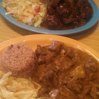 Photo taken at Carena's Jamaican Grille by A C. on 3/5/2015