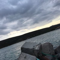 Photo taken at Altay's beach by Kaan A. on 9/27/2018