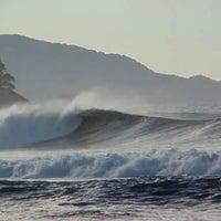 Photo taken at Praia Itamambuca by Guilherme O. on 2/23/2013