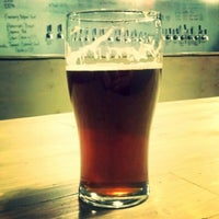 Photo taken at Thompson Brewing Co. by Cody S. on 1/9/2015