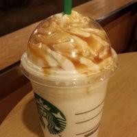 Photo taken at Starbucks by Stella L. on 11/15/2013