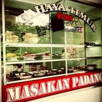 Photo taken at Rumah Makan Cahaya Timur (masakan padang) by Junaidi T. on 7/30/2013