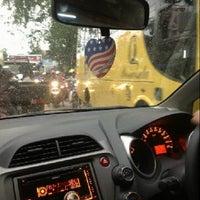 Photo taken at Jalan Otto Iskandardinata by Eric R. on 4/17/2013