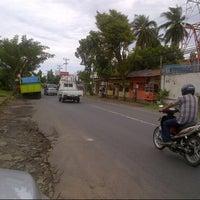 Photo taken at Jalan Raya Airmadidi - Manado by ENDO K. on 8/22/2013