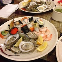 Photo taken at Osaka Japanese Seafood Buffet by Daria F. on 3/12/2014
