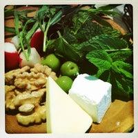 Photo taken at Rumi's Kitchen by Tara S. on 7/19/2013