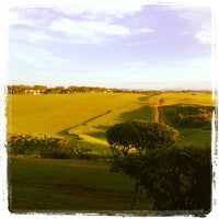 Photo taken at Dye Fore Golf Course by Ruben G. on 10/10/2013