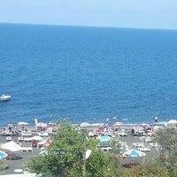 Photo taken at Akçakale plajı by Elif Özge A. on 8/8/2014