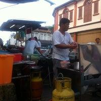 Photo taken at Kampung Malabar Porridge by Eric L. on 1/22/2013