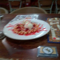 Photo taken at Strawberry Cafe by Ayu Z. on 10/14/2013