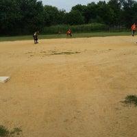 Photo taken at Kissena Park Softball Fields by Steven T. on 8/11/2014