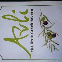 Photo taken at Avli Little Greek Tavern by Steven T. on 9/26/2012