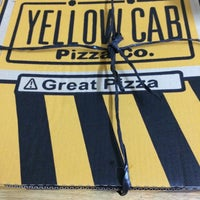 Photo taken at Yellow Cab Pizza Co. by Karen P. on 4/16/2014