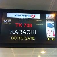 Photo taken at Gate 217 by Yasin Ö. on 7/24/2013