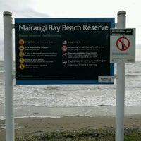 Photo taken at Mairangi Bay Beach by Hav B. on 9/30/2016