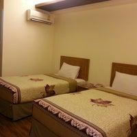 Photo taken at TM Land Serviced Hotel by Poppy L. on 11/14/2012