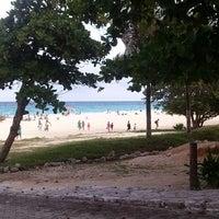 Photo taken at Playa Xaman-Ha by Mariana V. on 7/5/2013