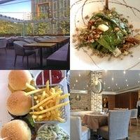 Photo taken at Déjàvu Restaurant by Elham M. on 8/23/2014