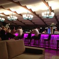 Photo taken at Granada Lobby Bar by Kamuran Y. on 9/10/2013