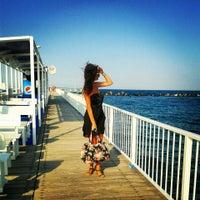 Photo taken at Cetate Beach by Alexandra H. on 7/8/2014