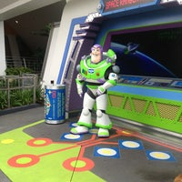 Photo taken at Buzz Lightyear's Space Ranger Spin by Mary W. on 7/21/2013