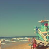 Photo taken at Suma Beach by Ecem K. on 7/6/2013