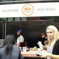 Photo taken at Milk Truck Grilled Cheese at South Street Seaport by Ian M. on 9/14/2013