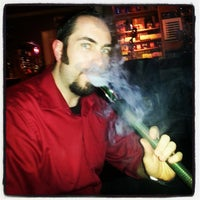 Photo taken at Oasis Cafe And Hookah Lounge by Chris W. on 9/21/2013