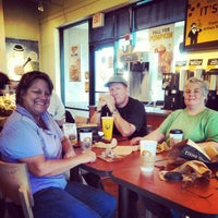 Photo taken at Einstein Bros Bagels by Ken F. on 9/22/2013